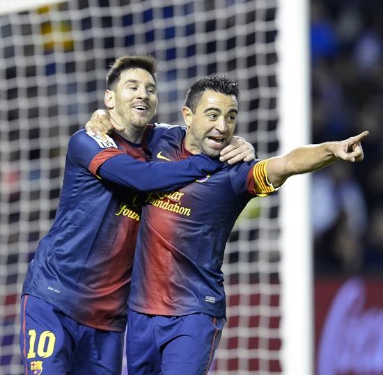 Barcelona's Xavi Hernandez (centre), Lionel Messi