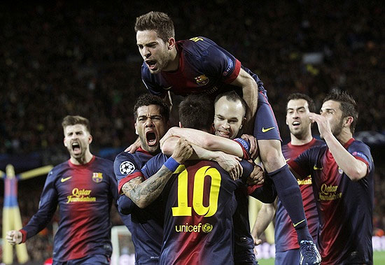 Barcelona's Lionel Messi (10) is congratulated by team mates Dani Alves (left), Jordi Alba (top) and Andres Iniesta
