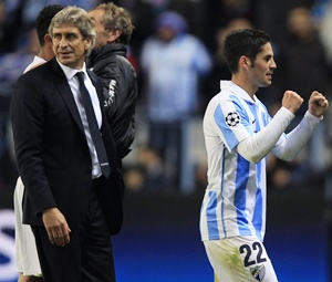 Malaga's Isco (right) celebrates next to his coach Manuel Pellegrini