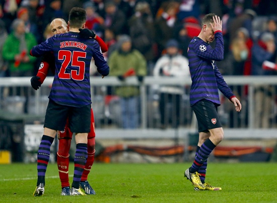 Arsenal's Laurent Koscielny (right) reacts as his teammate Carl Jenkinson bids farewell to Bayern Munich's Arjen Robben