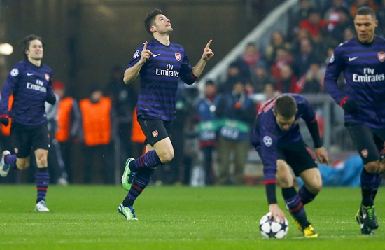 Olivier Giroud (centre) of Arsenal celebrates his goal against Bayern Munich