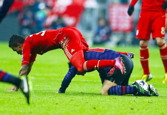 Bayern Munich's Luiz Gustavo (left) falls over Arsenal's Santi Cazorla