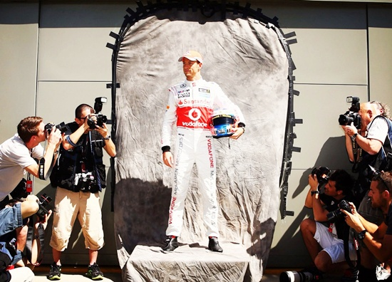Jenson Button of McLaren poses for photographers