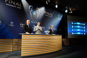 Gianni Infantino, UEFA General Secretary, Steve McManaman, UEFA Champions League Final Ambassador, and Giorgio Marchetti, UEFA Competition Director, draw the last ball during UEFA Champions League quarter-finals draw at the UEFA headquarters in Nyon, Switzerland on Friday
