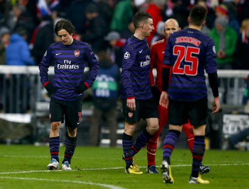 Arsenal's Tomas Rosicky (L) reacts following his team's Champions League round of 16 second leg soccer match against Bayern Munich