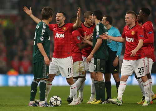Ryan Giggs of Manchester United reacts after Nani is sent off during the UEFA Champions League