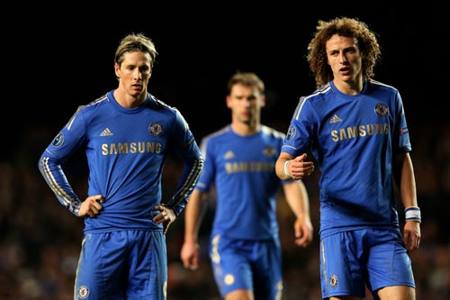 Chelsea players walk off the pitch