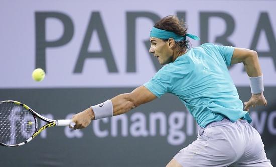 Rafael Nadal of Spain returns a shot