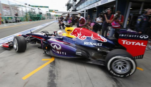 Red Bull Formula One driver Sebastian Vettel of Germany leaves his pit during the first practice session of the Australian GP