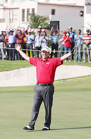 Thomas Aiken of South Africa celebrates victory on the 18th green after a birdie putt during day four of the Avantha Masters at Jaypee Greens Golf Club on Sunday