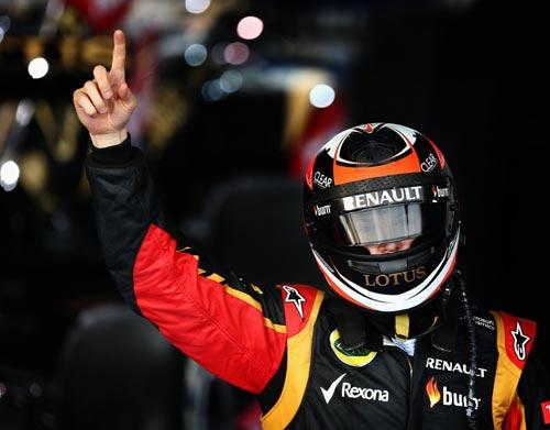 Kimi Raikkonen of Finland and Lotus celebrates in parc ferme after winning the Australian Formula One Grand Prix