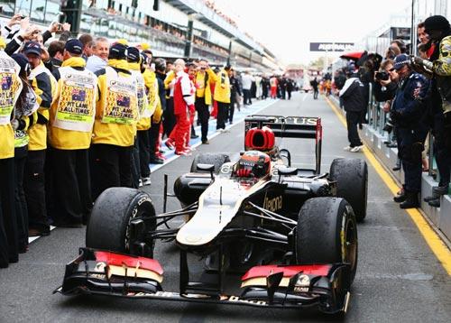 Kimi Raikkonen of Finland and Lotus drives into parc ferme after winning the Australian Formula One Grand Prix