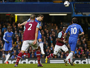 Chelsea's Frank Lampard (centre) heads to score against West Ham during their English Premier League match at Stamford Bridge in London, on Sunday. It was his 200th goal for The Blues