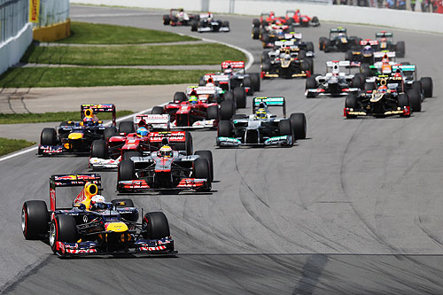 Sebastian Vettel of Germany and Red Bull Racing leads the field into the first corner at the start of the Canadian Formula One Grand Prix at the Circuit Gilles Villeneuve on June 10, 2012 in Montreal, Canada