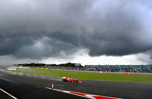 Fernando Alonso of Spain and Ferrari drives on his way to finishing first during qualifying for the British Grand Prix at Silverstone Circuit on July 7, 2012 in Northampton, England