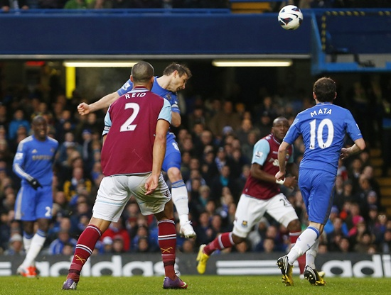 Frank Lampard of Chelsea (centre) heads to score against West Ham