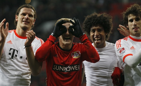 From left, Bayern Munich's Daniel van Buyten, Bastian Schweinsteiger, Dante and Javier Martinez celebrate their victory
