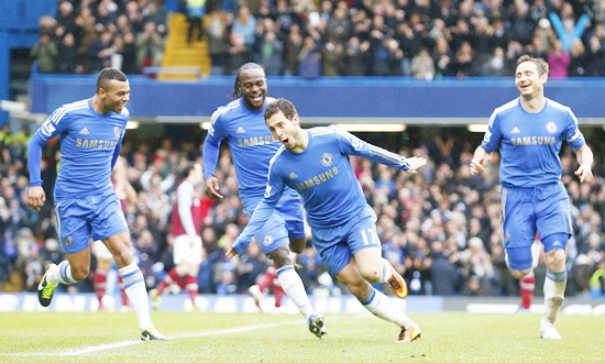 Eden Hazard of Chelsea (centre) celebrates scoring against West Ham