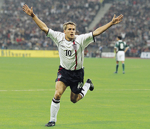 Michael Owen of England celebrates scoring a goal enroute a hat-trickduring the FIFA 2002 World Cup Qualifier against Germany played at the Olympic Stadium in Munich in September 2001