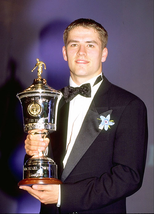 Michael Owen of Liverpool with the Young Player of the Year trophy at the PFA Awards in April 1998