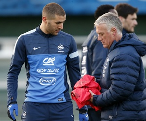 France's coach Didier Deschamps (right) passes by Karim Benzema