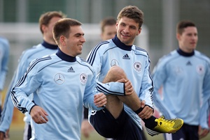 Germany's Philipp Lahm (left) and Thomas Mueller attend a training session