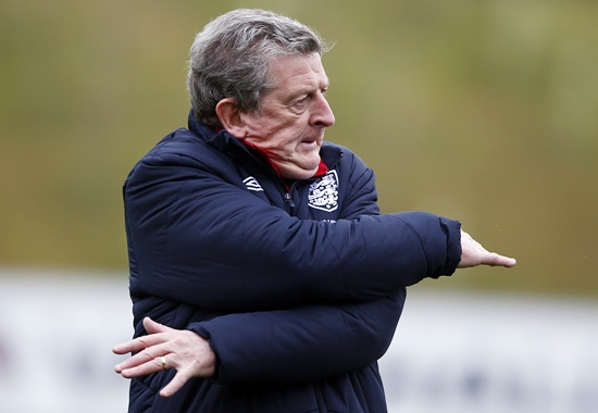 England manager Roy Hodgson stretches