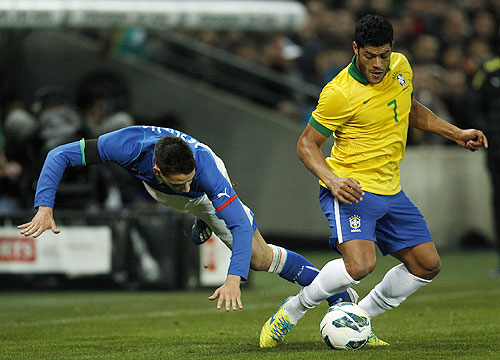 Italy's Mattia De Sciglio is tackled by Brazil's Hulk as they vie for possession during their international friendly at the Stade de Geneve in Geneva on Thursday