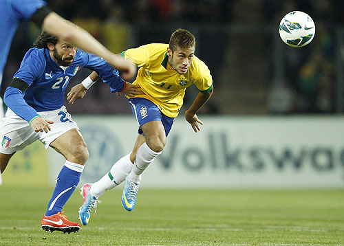 Italy's Andrea Pirlo (left) and Brazil's Neymar vie for possession during their international friendly at the Stade de Geneve in Geneva on Thursday