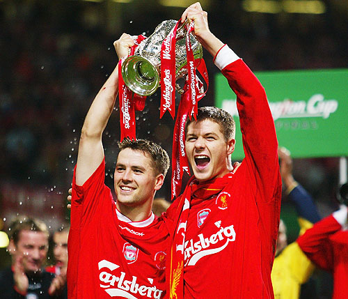 Goalscorers Michael Owen and Steven Gerrard of Liverpool celebrate with the trophy during the Worthington Cup Final between Liverpool and Manchester United held on March 2, 2003 at the Millennium Stadium, in Cardiff, Wales. Liverpool won the match and final 2-0
