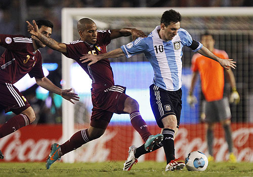 Argentina's Leonel Messi is chased by Venezuela's Romulo Otero (centre) and Andres Tunez (left) during their World Cup qualifying match in Buenos Aires on Friday