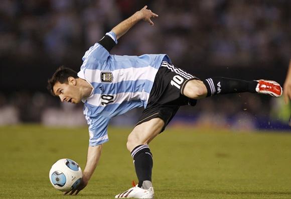 Argentina's Leonel Messi loses his balance