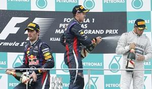 Sebastian Vettel (centre), teammmate Mark Webber and Lewis Hamilton of Britain (right)