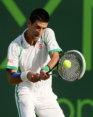 Novak Djokovic of Serbia plays a backhand against Somdev Devvarman of India during their third round match at the Miami Masters at Crandon Park Tennis Center in Key Biscayne, Florida on Sunday
