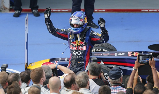 Red Bull Formula One driver Sebastian Vettel celebrates winning