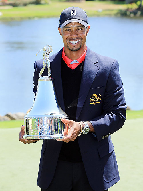 Tiger Woods of the United States holds the trophy after winning the final round of the 2013 Arnold Palmer Invitational at Bay Hill Golf and Country Club in Orlando, Florida on Monday