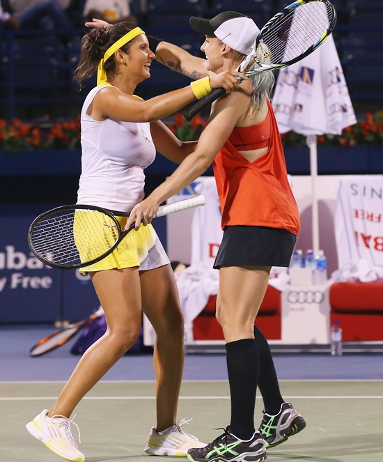 Bethanie Mattek-Sands of USA (right) celebrates winning the match with partner Sania Mirza