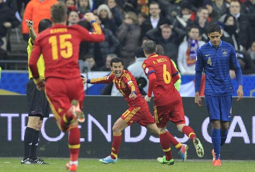 Spain's Pedro Rodriguez Ledesma (C) celebrates after scoring goal against France