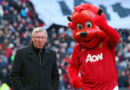 Manchester United Manager Sir Alex Ferguson with Mascot Fred the Red