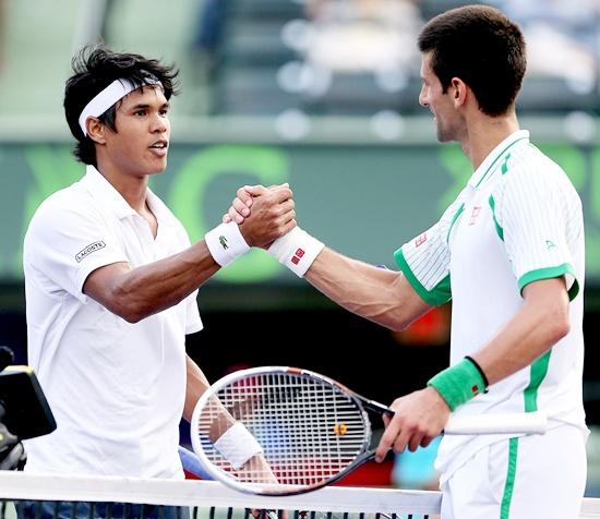 Somdev Dewarman congratulates Novak Djokovic after their match at the Sony Open in Key Biscayne, Florida