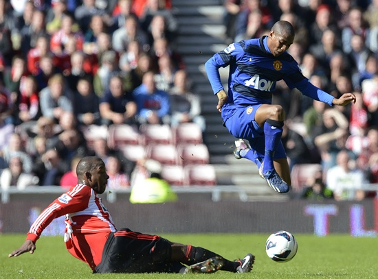 Sunderland's Titus Bramble (left) challenges Manchester United's Ashley Young