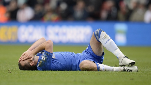 Chelsea's captain John Terry lies on the ground