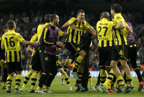 Borussia Dortmund players celebrate after the Champions League semi-final second leg soccer match against Real Madrid at Santiago Bernabeu stadium in Madrid