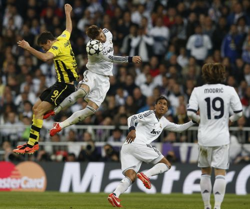 Real Madrid's Sergio Ramos (2nd L) and Borussia Dortmund's Robert Lewandowski (L) jump to head the ball during their Champions League semi-final second leg soccer match at Santiago Bernabeu stadium in Madrid