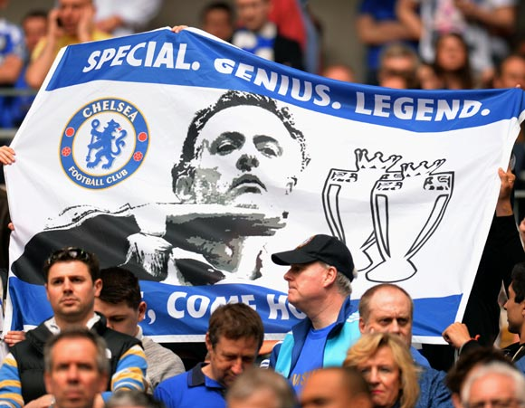 Chelsea fans hold up a banner in support of former coach Jose Mourinho
