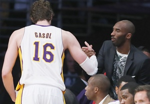 Los Angeles Lakers Pau Gasol of Spain (left) shakes hands with injured guard Kobe Bryant