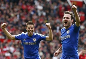 JUan Mata (right) celebrates after scoring