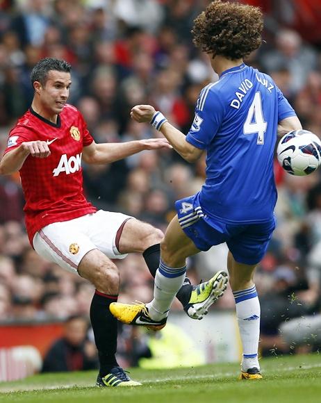 Chelsea's David Luiz challenges Manchester United's Robin van Persie (left)