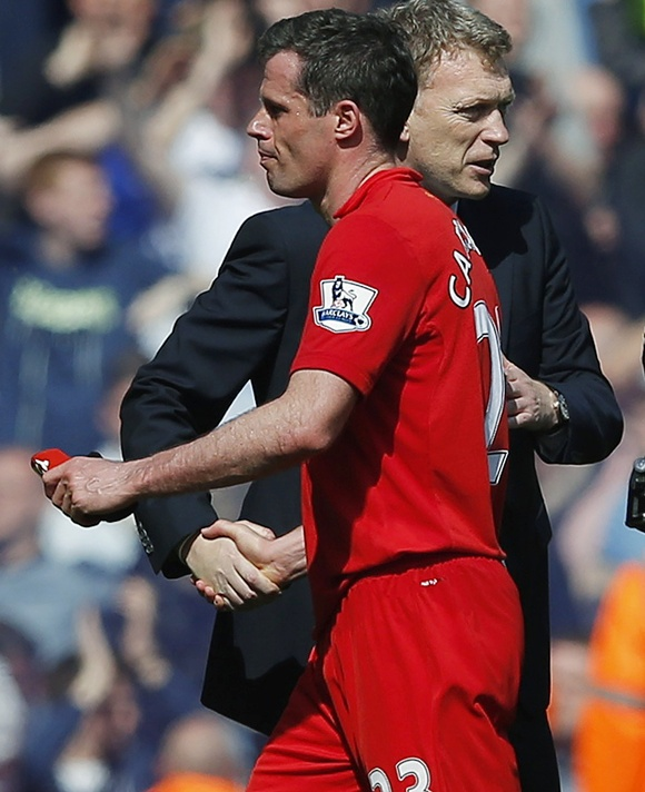 Everton's manager David Moyes (right) shakes hands with Liverpool's Jamie Carragher