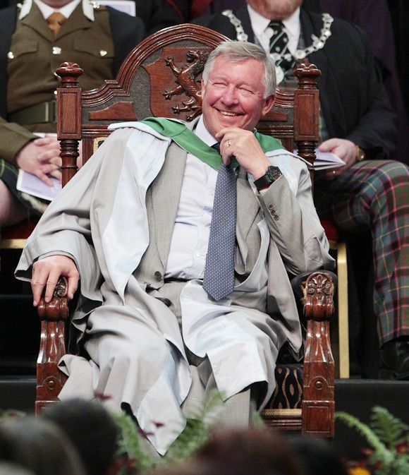 Sir Alex Ferguson smiles before being awarded an honorary   doctorite degree during a graduation ceremony at Stirling   University in Stirling, Scotland on June 29, 2011.
